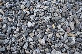 Gravel Rock Texture. Crushed Stone And Gravel On The Ground. Texture Background Brown Stones On A Bl poster