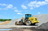 Yellow Wheel Loader On A Cement Production Site. Loading Of Gravel, Rubble, Stones In The Mining Qua poster