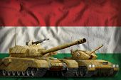 Tanks With Orange Camouflage On The Hungary Flag Background. Hungary Tank Forces Concept. 3d Illustr poster