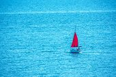 Red Sail Yacht In The Blue Calm Sea. A Yacht In Peaceful Waters. poster