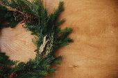 Christmas Rustic Wreath Flat Lay. Creative Rural Christmas Wreath With Fir Branches, Berries, Pine C poster