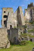 Scenic Ruins Of Ancient Castle  Likava Outside On Blue Cloudy Sky Background. Liptov Region. Slovaki poster