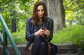 Worried Girl Looking At Cell Phone. Worried Girl Looking At Cell Phone Message. Upset Girl Reading M poster