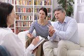 image of psychologist  - married couple consults talking to psychologist - JPG