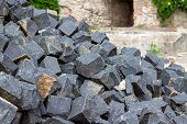 A Pile Of Stones Of Building Materials. Stones For Masonry Pavement And Sidewalk. Building Granite D poster