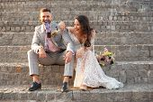 Caucasian Romantic Young Couple Celebrating Marriage In City. Tender Bride And Groom On Modern Citys poster