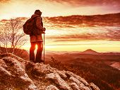 Young Smiling Woman Hiker Hiking Mountain Trail, Walking On Rocky Hill, Wearing Backpack And Knitted poster