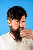 Healthy Nutrition. Drinking Water. Handsome Bearded Man Holds Glass Of Fresh Water. Man Drinking Wat poster