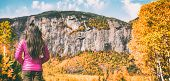 Hike travel autumn hiker woman walking camping in Quebec Canada forest outdoors with mountain backgr poster