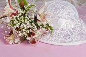 stock photo of baptism  - Arrangement with flowers and favors for wedding baptism and First Communion - JPG