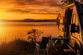 Class B Motorhome Rv And The Scenic Sea Front Sunset. Road Trip Camping. Recreation Vehicle Theme. poster