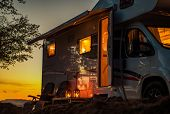 Scenic Rv Camping Spot During Sunset. Class C Motorhome Camper Van. Travel Industry Theme. poster