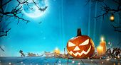 Spooky halloween pumpkin in forest. Scary halloween background with free space for text. poster