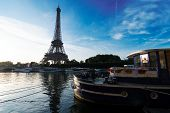 Paris Eiffel Tower Reflecting In River Seine At Sunrise With Moored Boats In Paris, France. Eiffel T poster