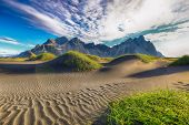 Fantastic Sunny Day And Gorgeous Black Sand Dunes On Stokksnes Cape In Iceland. Location: Stokksnes  poster