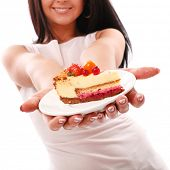 foto of fat lip  - Piece of cake on a plate in woman hands - JPG