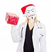 foto of guy fawks  - Medical doctor with a guy fawkes mask - JPG