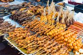 stock photo of sate  - Variety of Asian style barbecue stick food - JPG