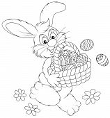 stock photo of cony  - Rabbit friendly smiling and carrying a basket with colorfully painted Easter eggs - JPG