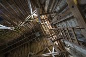 Old Wooden Barn Roof With Light Shining Through Wooden Boards
