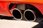 stock photo of exhaust pipes  - Close up of a red car dual exhaust pipe