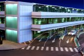 stock photo of parking lot  - A Parking Garage at the Airport during the Night - JPG