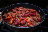 foto of crawfish  - A beautiful skillet full of crawfish jambalaya. This dish was created in the southern United States in Lousiana.