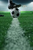 picture of defender  - Close up of foot on top of soccer ball on the line - JPG