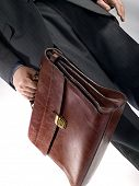 picture of hustle  - businessman with bag - JPG