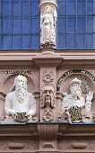 stock photo of building relief  - reliefs on the building of an ancient Apothecary Oriel in the city of Lemgo Germany - JPG