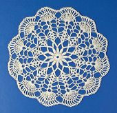 pic of doilies  - Handmade doily on blue background - JPG