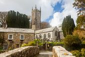 pic of church-of-england  - The Church of St Nonna and Pack Horse bridge at Altarnun on Bodmin Moor Cornwall England UK Europe - JPG