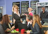 image of enthusiastic  - Enthusiastic cafe owner talking with group of customers - JPG