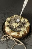 stock photo of cheesecake  - Cheesecake with black sesame seeds on Halloween - JPG