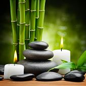 picture of ayurveda  - zen basalt stones and candle on the wood - JPG