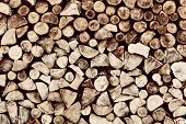 Pile of brown wood logs background, pattern. Vintage tone