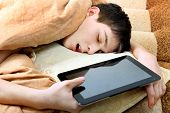 Teenager Sleeps With Tablet
