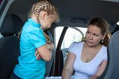 Resentful Child Refusing Get In Safety Car Seat Under Mother Severe Look