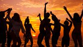 stock photo of break-dance  - Young People Dancing On Beach at Sunset - JPG