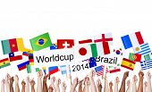 stock photo of flags world  - Raised Arms Holding National Flags and World Cup Banner - JPG