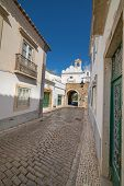 Old village street in Faro, Algarve, Portugal