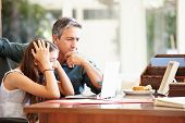 picture of 13 year old  - Father Helping Stressed Teenage Daughter Looking At Laptop - JPG