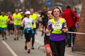 KRAKOW, POLAND - MAR 23, 2014: Unidentified participants during the annual Krakow international Mara