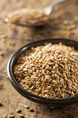 stock photo of flax seed oil  - Organic Raw Flax Seeds in a Bowl