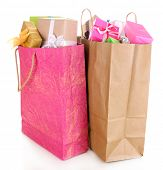 Presents in paper bags isolated on white