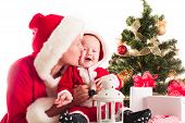stock photo of christmas baby  - Christmas baby and mom under the fir tree isolated - JPG