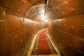 stock photo of catacombs  - Russian underground tunnel with lights and rails