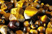 stock photo of tigers-eye  - Tiger Eye Stones Ready to Make Handmade Jewelry - JPG