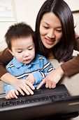 pic of mother child  - A portrait of a mother and a son using a laptop - JPG