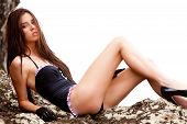 image of swimsuit model  - An attractive young woman wearing a black one - JPG